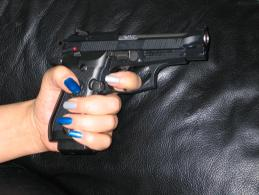 Let's see, which nail color goes best with the Beretta...?